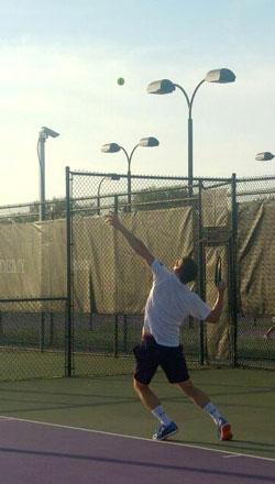 RAF Tennis player serves